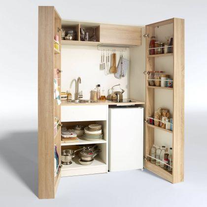 La cuisine qui se range dans un placard