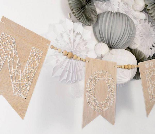 DIY : Fabriquez une guirlande de Noël en bois brodé