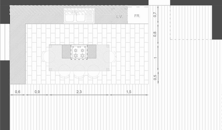 Zoom sur la cuisine avec îlot central.